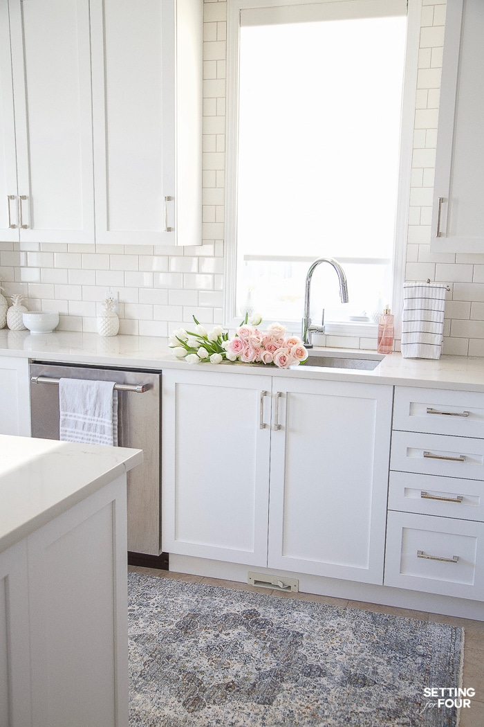 White kitchen decorated for Spring #white #kitchen #cabinets #spring #decor