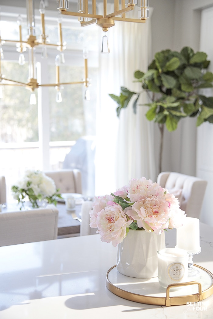 Artificial flowers in a vase to decorate a kitchen island. #decor #decorate #ideas #kitchen #island #spring #peonies