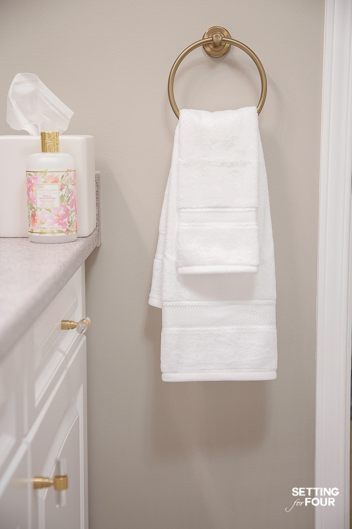 Layer hand towels on a towel ring to decorate a bathroom. #towelring #brass #bathroom #towel #storage #decorate