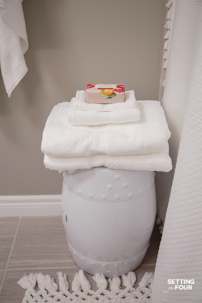 Stack bath towels on a garden stool - so handy when you hop out of the shower! #bathroom #decorations #towels #stool #makeover