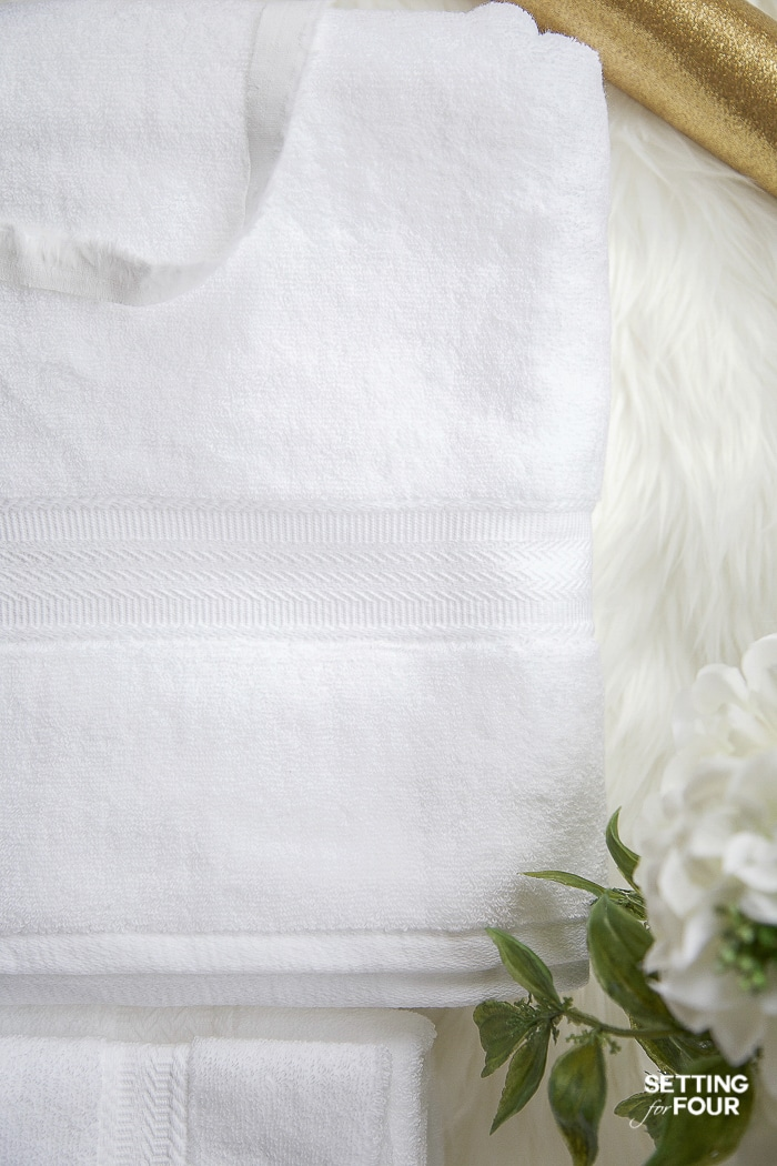 Gorgeous white towels with a beautiful border design to decorate a bathroom. #bathroom #towel #styling #ideas #spa