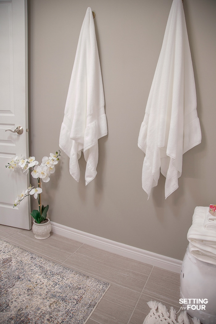 Hang towels on hooks. Bathroom decor and storage idea! #bathroom #organization #storage #hooks #towels