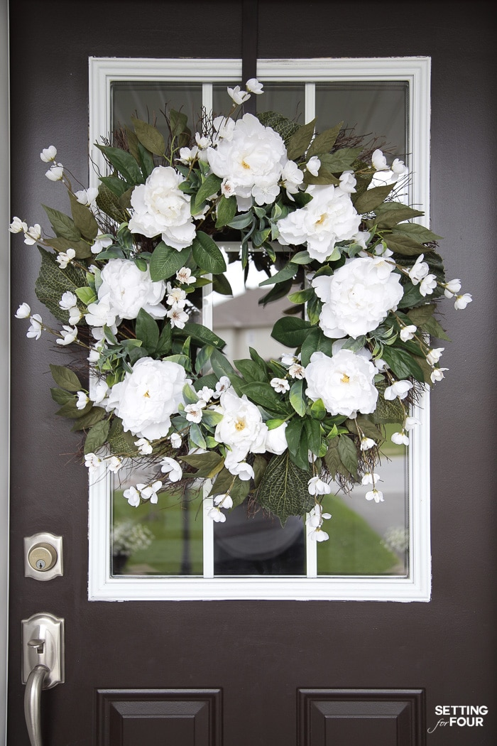 Farmhouse wreath on a front door.