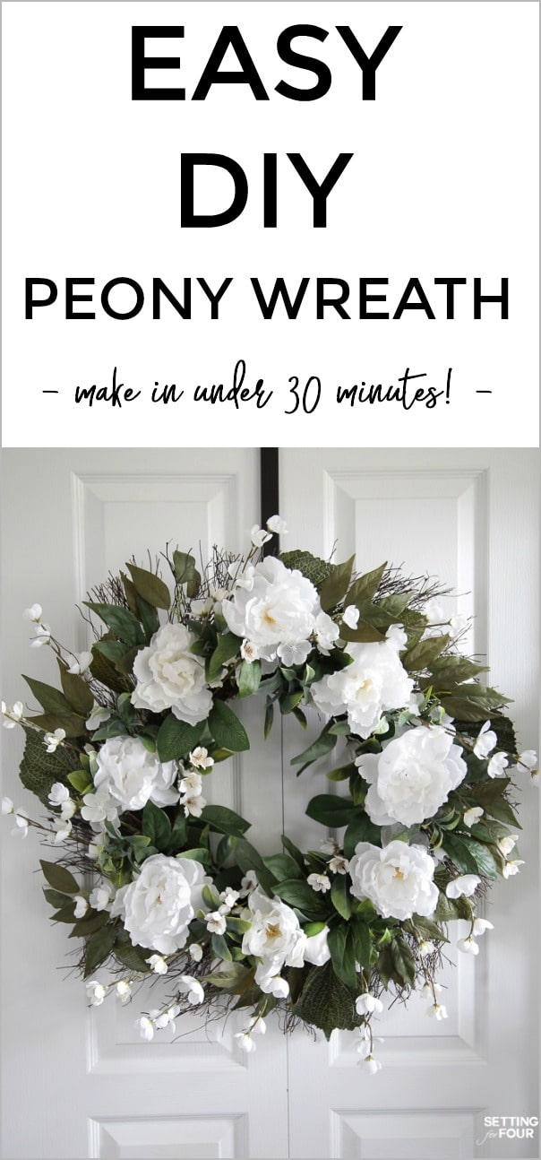 Diy Peony wreath hanging on a white door.