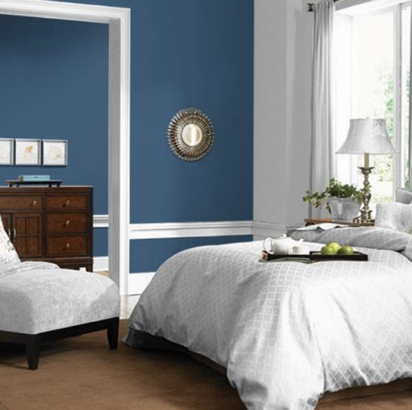 Bedroom walls painted blue.