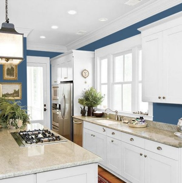 WHite kitchen with blue wall paint.