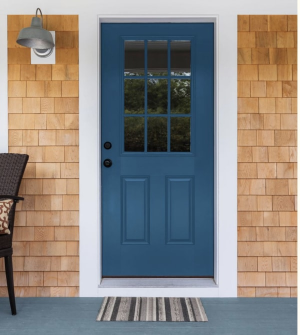 Blue front door color and blond wood shingles.