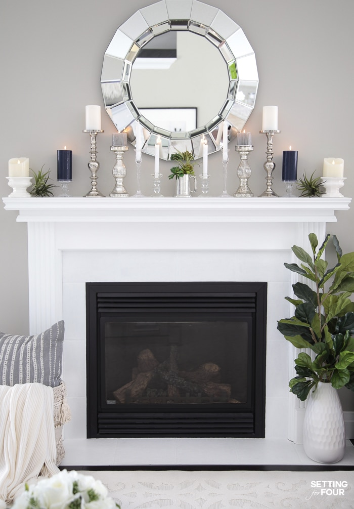 White fireplace mantel and tile.