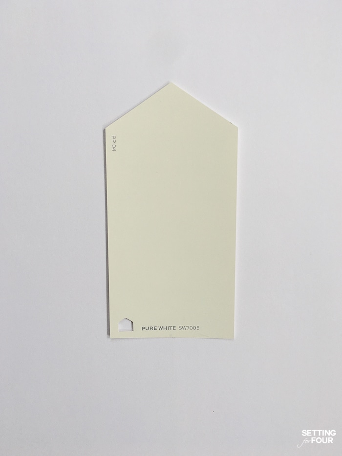 Sherwin Williams Pure White paint chip on a piece of printer paper.