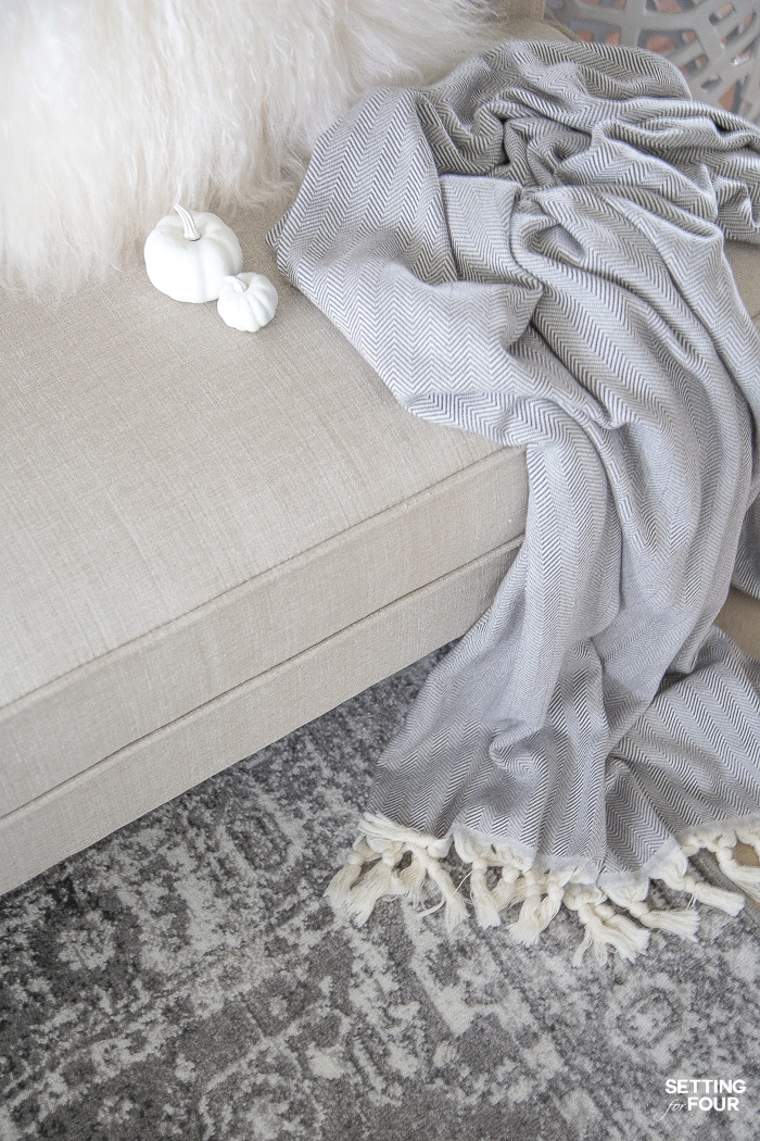 4 Fall Entryway Decor Ideas: Simple Ways To Welcome Autumn Into Your Home. I LOVE this gray and ivory area rug and gray throw blanket!