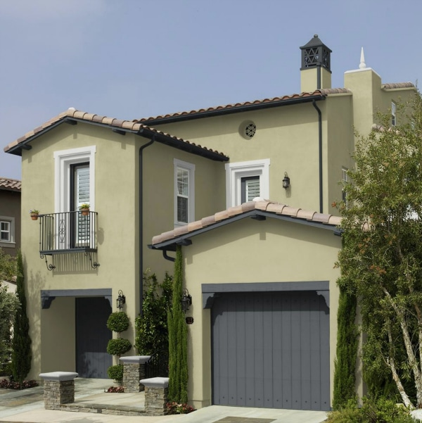 See this beautiful home exterior with stucco painted Back To Nature by Behr. Color of the Year 2020.