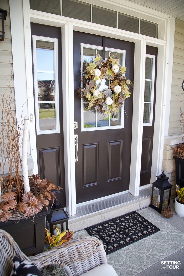Fall decorated front door with layered door mats.