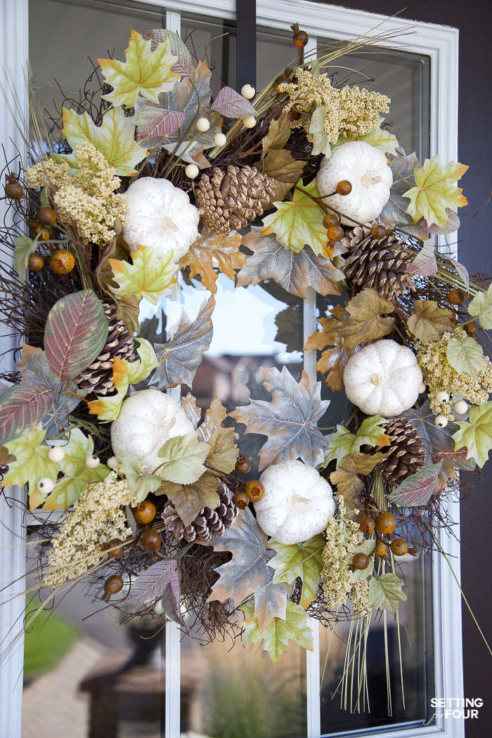 Neutral Fall Porch Wreath to decorate your front door with white pumpkins and fall leaves.