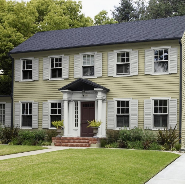 See this beautiful home exterior with siding painted Back To Nature by Behr. Color of the Year 2020.