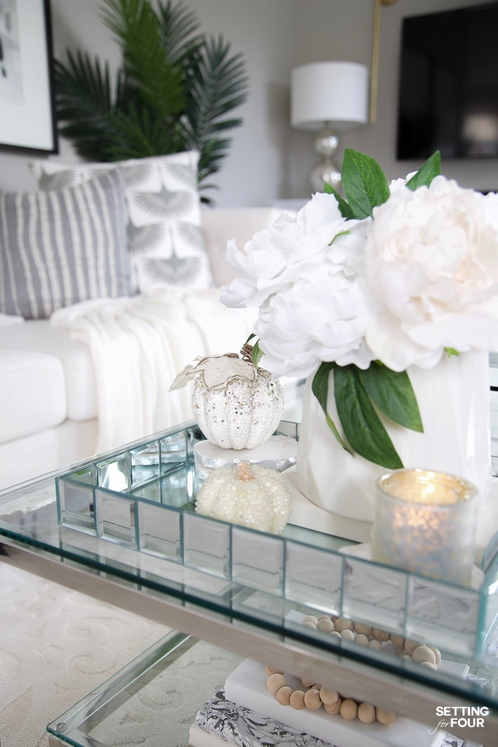 Elegant Fall Living Room Decor Ideas with white sparkle pumpkins.