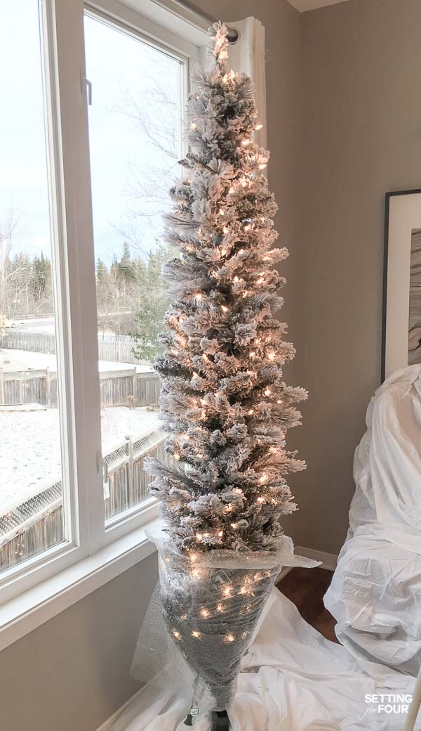 How to put up a flocked Christmas tree without the mess!