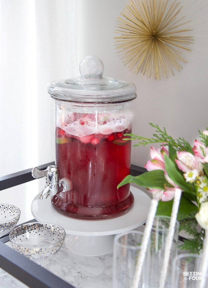 Holiday Sherbet punch recipe in a glass drink dispenser.