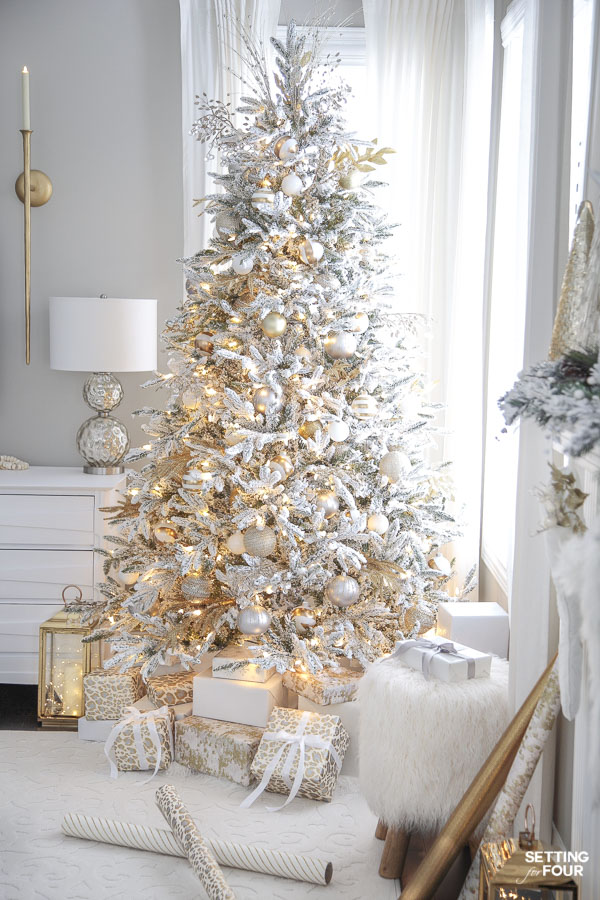 Learn how to create this gorgeous decorated flocked Christmas tree with gold and white ornaments!