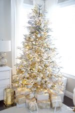 Elegant Gold and White Flocked Christmas Tree