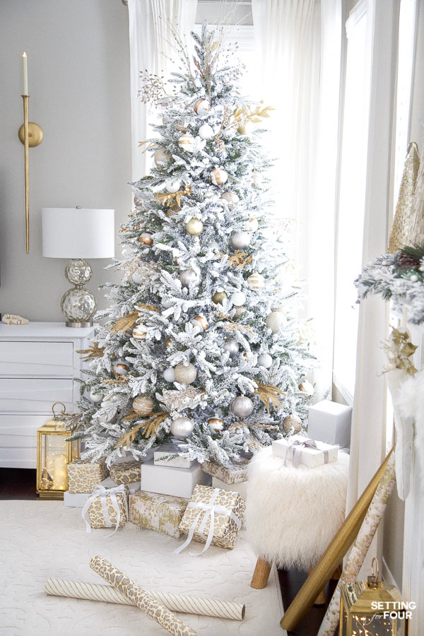 Learn how to decorate this gorgeous and elegant living room Christmas tree with Christmas sprays and ornaments!