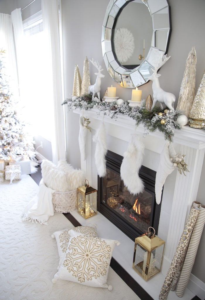 Gold and White Living Room Fireplace Mantel Decor Ideas with deer and glass Christmas trees.