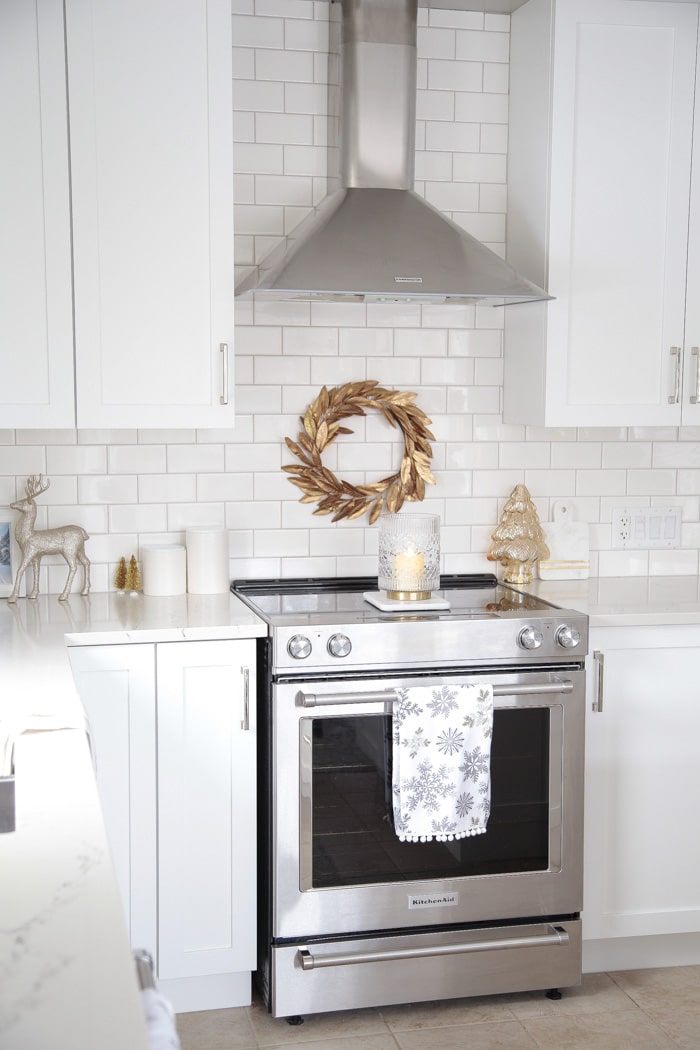 Christmas wreath over stove and holiday kitchen counter decor ideas.