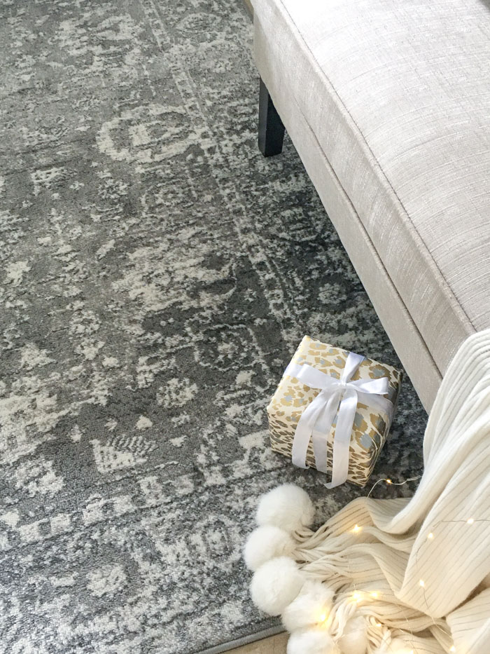 Beautiful gray and ivory area rug in the foyer for Christmas style.