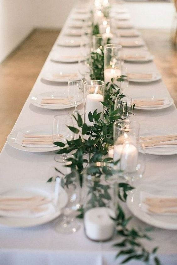 Simple elegant table setting with candles for winter
