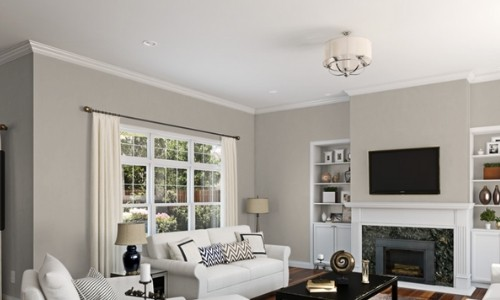 Living room painted Sherwin Williams Agreeable Gray! It's one of the most popular TOP 50 paint colors at Sherwin Williams.