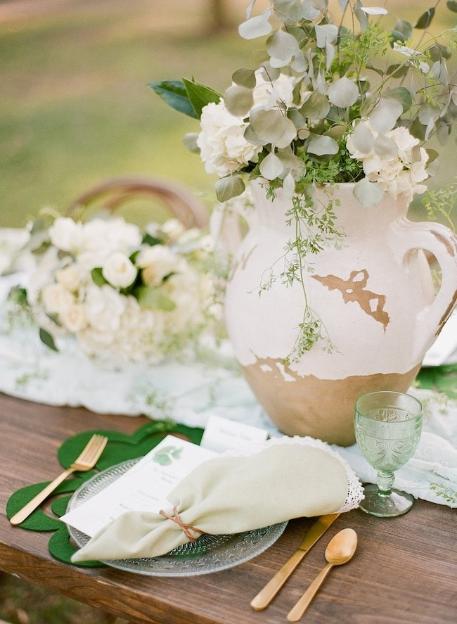 Modern farmhouse St. Patrick's Day tablescape idea with shamrock menu cards.