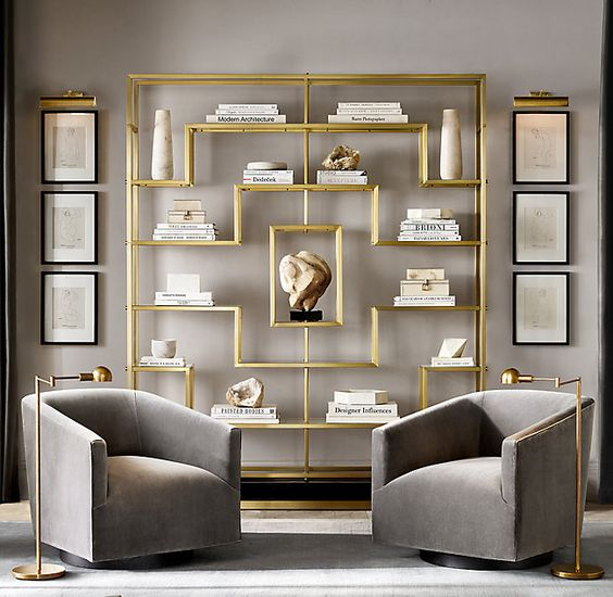Living room armchair furniture arrangement idea with bookcase as a focal point.