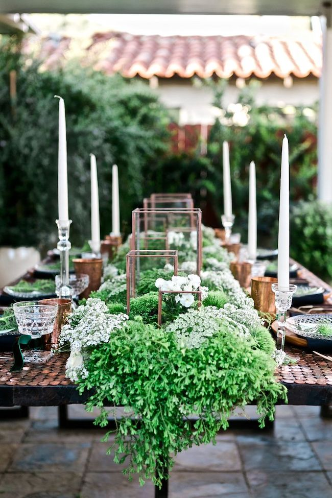 Copper and green St. Patrick's Day Table Decor Idea with florals, ferns and moss.
