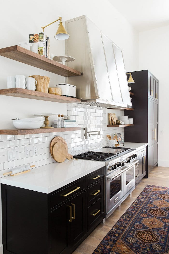 Kitchen cabinets painted Tricorn Black Sherwin Williams. It's one of the most popular TOP 50 paint colors at Sherwin Williams.