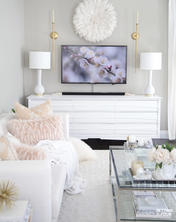Living room design with TV unit, TV wall decor, white sofa, coffee table and Mindful Gray walls.