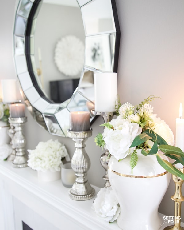 Summer Mantel Decorating Ideas with ginger jars, flowers, candle holders and white decor in living room. Sherwin Williams Mindful Gray paint color on walls