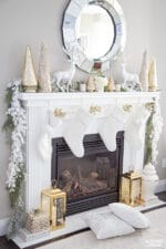 Happy Holidays! Gold and white Christmas mantel with elegant, glam decor.